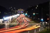 Street Traffic In Chicago At Night. Busy Traffic On Highway Road With Blurred Cars Light Trails High poster