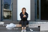 Poor Woman With Mug Begging And Asking For Help On City Street poster