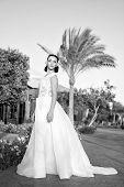 Stunning Beauty. Bride Luxury White Wedding Dress Sunny Day Tropic Nature Background. Tropic Wedding poster