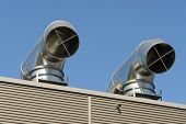 pic of air conditioning  - Two roof air condition outlets over blue sky - JPG