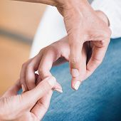 Female Hands At Theta Healing Treatment poster