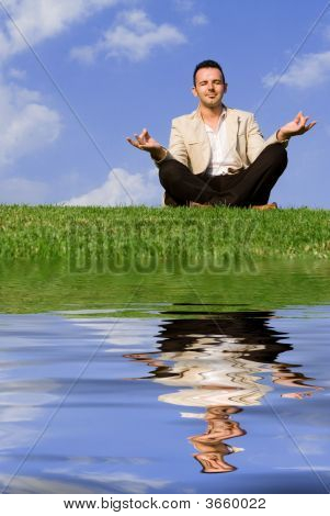 Man Meditating In Yoga Pose Outdoors