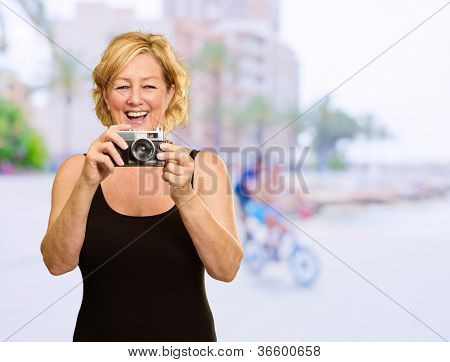 Happy Woman Standing With Photo Camera, Outdoor