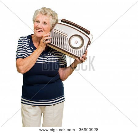 Portrait Of Senior Woman Listening Music From Radio Isolated Over White Background