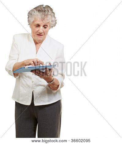 Senior woman using ipad isolated on white background