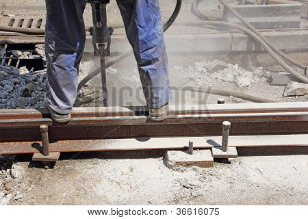 Worker With Pneumatic Hamme