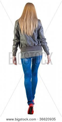 walking blonde woman in motion. during a walk.  going girl back view . Rear view people collection.  backside view of person.  Isolated over white background.