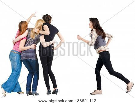 Back view of group pointing young women. girl hastens to join friends.  Rear view people collection. backside view of person. Isolated over white background.