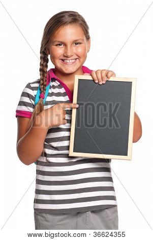 Schoolgirl with small blackboard - isolated on white background