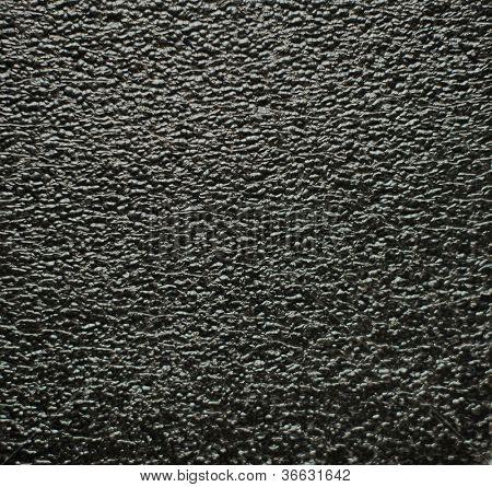 background with black foamed plastic as texture