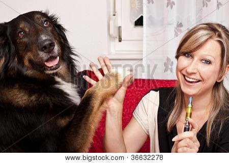 Young Woman With Dog And E-cigarette
