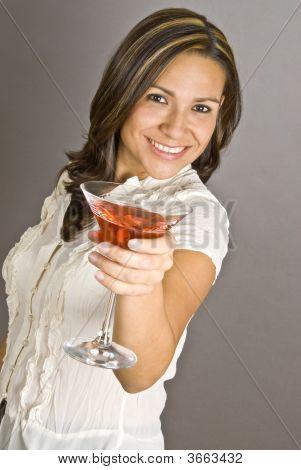 Hispanic Woman Holding A Glass Of Martini
