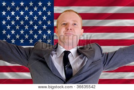 Happy Businessman Because Of Profitable Investment In America Standing Near Flag