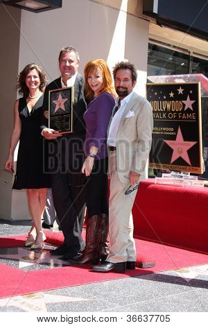 LOS ANGELES - SEP 6:  Amy Grant, Vince Gill, Reba McEntire,Tony Brown at the Hollywood Walk of Fame Ceremony for Vince Gill at Hard Rock Cafe Hollywood on September 6, 2012 in Los Angeles, CA