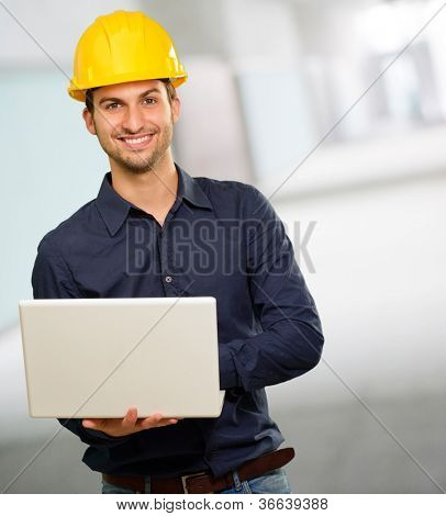 Technician Holding Laptop, Indoor