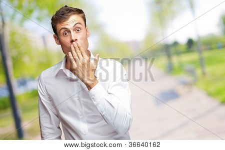 Portrait Of Young Man Covering His Mouth With Hand, Outdoor