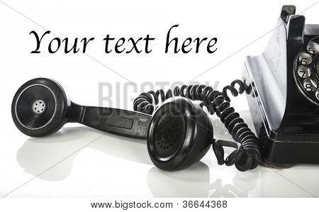 Vintage phone on white