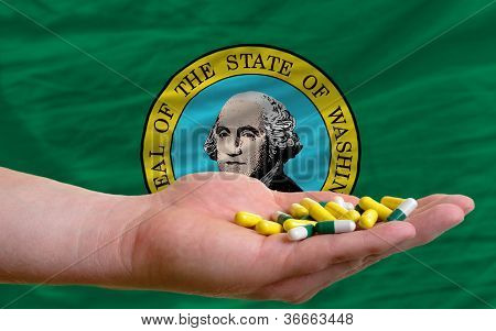 Holding Pills In Hand In Front Of Washington Us State Flag
