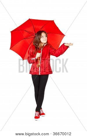 Girl Dressed In Raincoat Holding Umbrella Over White