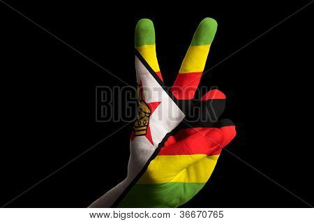 Zimbabwe National Flag Two Finger Up Gesture For Victory And Winner Symbol Made With Hand