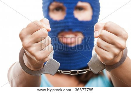 Russian protest movement concept - woman wearing balaclava or mask on head showing handcuffs on hands white isolated