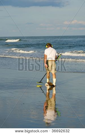 Senior citizen with the metal detector