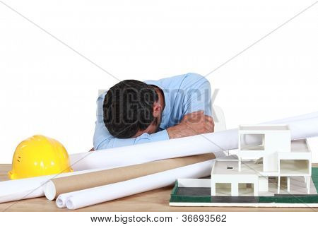 Architect asleep at desk