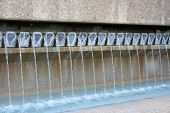 stock photo of water well  - a water fountain with water flowing out - JPG