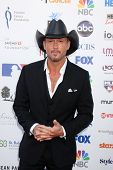 LOS ANGELES - SEP 7:  Tim McGraw arrives at the 2012 Stand Up To Cancer Benefit at Shrine on Septemb
