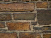image of fieldstone-wall  - stonework with medium to dark brown stones - JPG