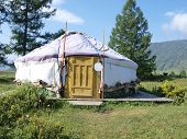 picture of yurt  - Traditional Altai yurt in the mountains with sky background - JPG
