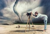 woman, taking photo by vintage camera and tornado (Photo compilation. Photo and hand-drawing element