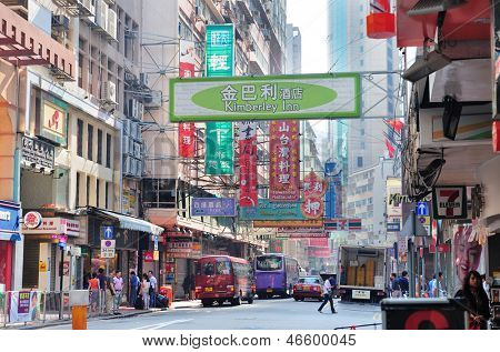 HONG KONG, CHINA - APR 23: Street view with traffic and shops on April 23, 2012 in Hong Kong, China. With 7M population and land mass of 1104 sq km, it is one of the most dense areas in the world.
