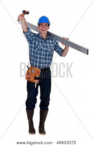 Cheerful builder holding rubber mallet in the air