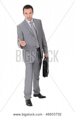 Businessman beckoning in a studio
