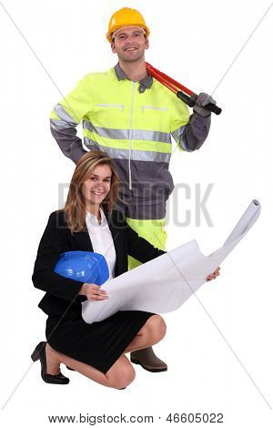 Tradesman and engineer standing side by side
