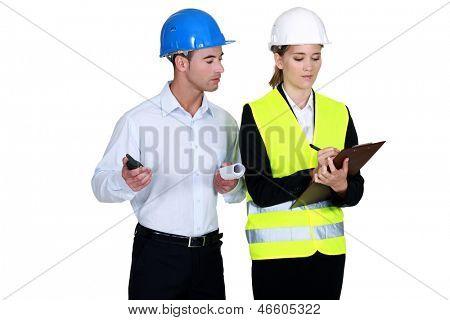 Engineer peering over shoulder