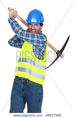 Aggressive labourer holding a pickaxe