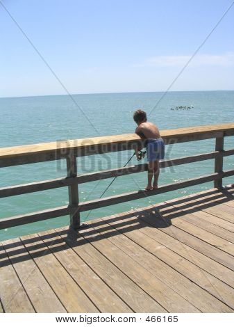 Little Boy Fishing Off Pier
