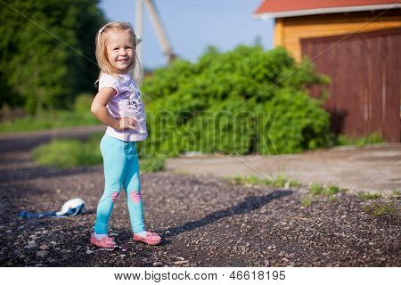 Little Girl Walking Outdoor, Having Fun And Laughting