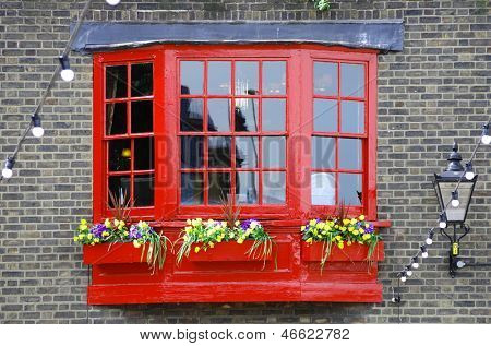 red wooden window georgian style on brickwall of Southwark, London