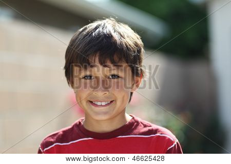 Young smiling boy outside