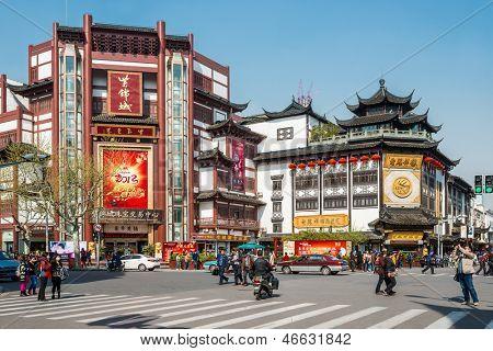 SHANGHAI - APRIL 7: people walking at the main street of  Fang Bang Zhong Lu  at old city of Shanghai in China on april 7th, 2013