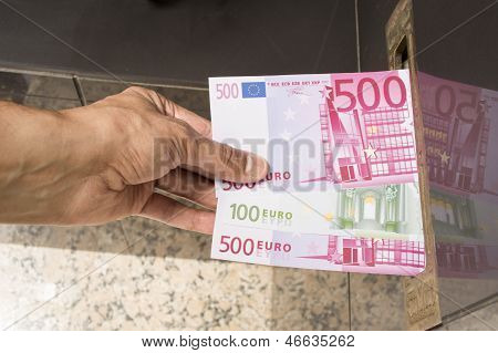 hand doing a mail in rebate euros notes
