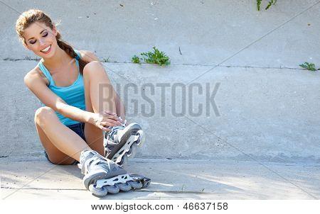 Roller girl resting on the steps