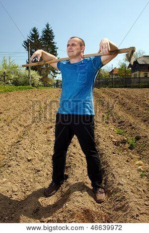 Man Working The Land