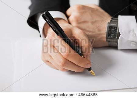 picture of businessman writing something on the paper