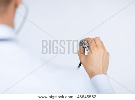 picture of doctor hand with stethoscope listening somebody