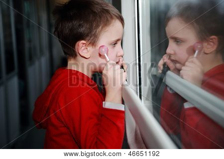 Child With Dreamy Eyes Facing Out The Window Of A Train.