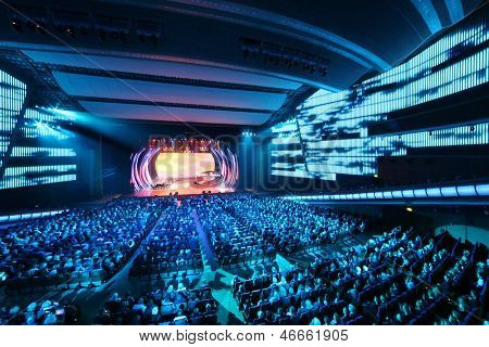 MOSCOW - OCTOBER 14: People look at stage at concert of Edyta Piecha at Kremlin Palace, on October 14, 2012 in Moscow, Russia. Singer during her lifetime became owner of large number of awards.